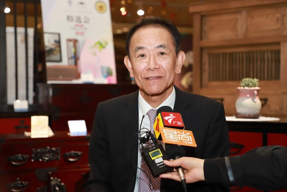 上海木神国际贸易有限公司冈本博彦社长接受媒体采访 毛志亮 摄