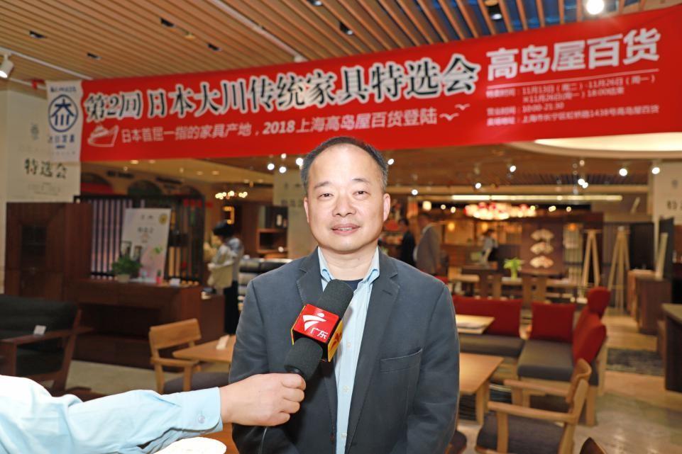 上海木神国际贸易有限公司龚晓煌专务接受媒体采访 毛志亮 摄