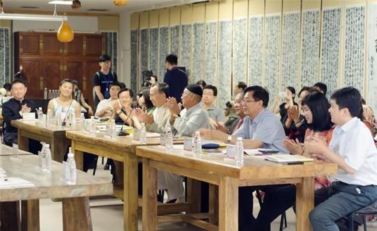 天下和谐——都本基书画艺术世界巡展研讨会在京召开