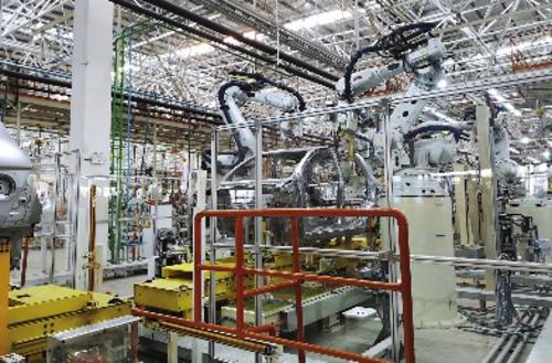 圖為蘇州協鑫科技新能源汽車生產線。郭丁源/攝